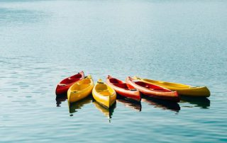 Kayaks floating in the middle of a lake
